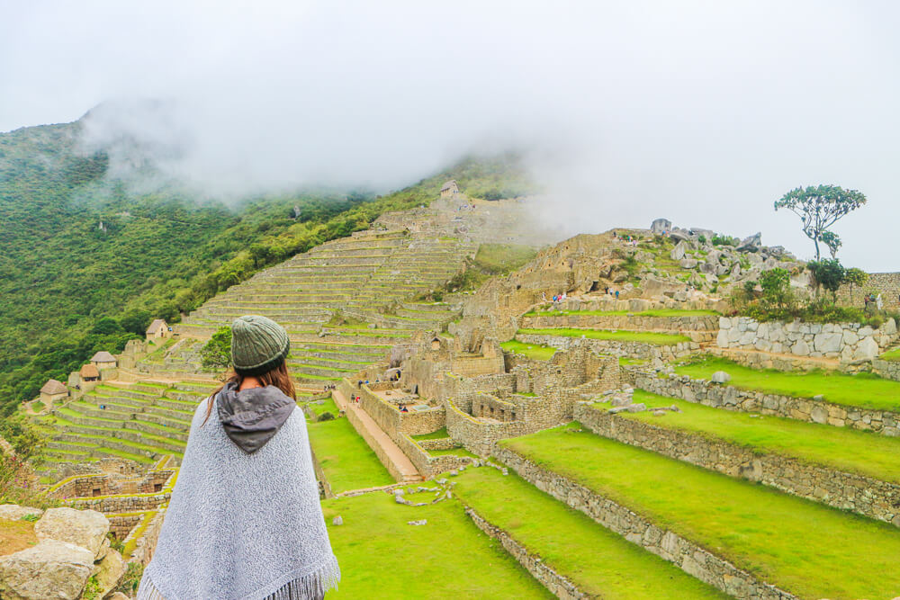 Enjoying the views at Machu Picchu - make sure to follow the new Machu Picchu rules to have the best experience