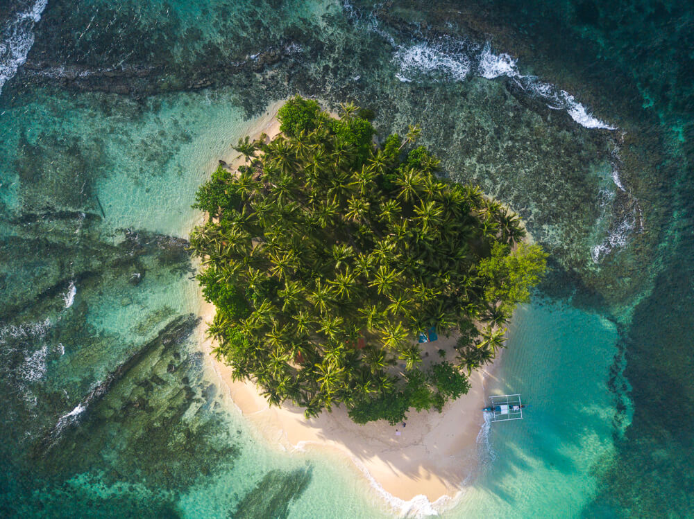 What to pack for the Philippines? A drone to get incredible aerial shots of islands like this!