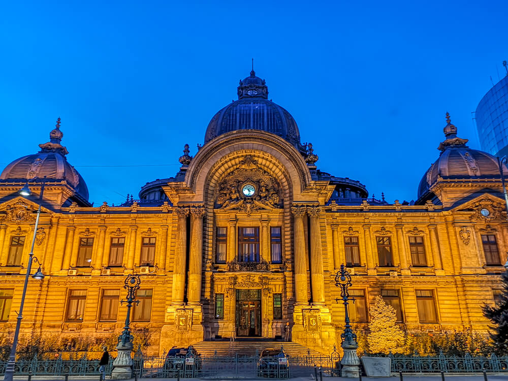 CEC Palace - beautiful architecture lit up at night in Bucharest