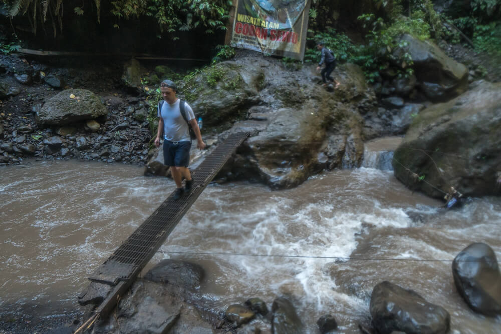 Metal bridge at Tumpak Sewu Waterfall