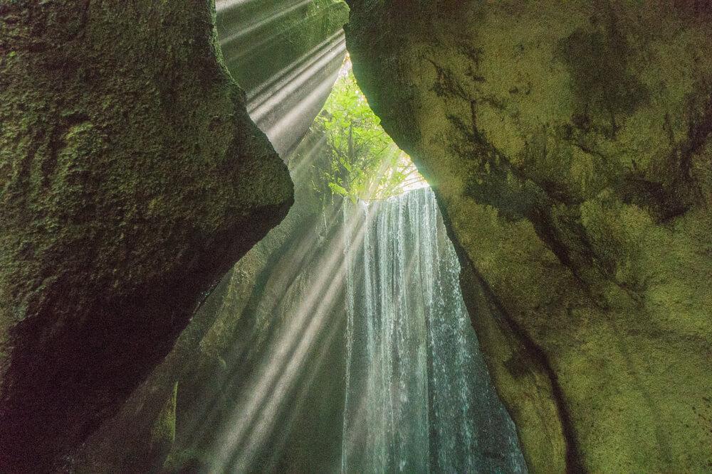 Tukad Cepung Cave Waterfall near Ubud, Bali