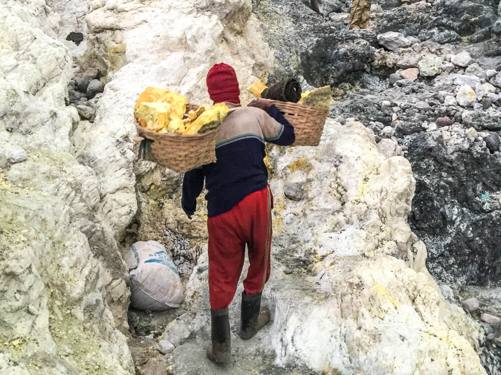 Sulphur miner working at Mount Ijen