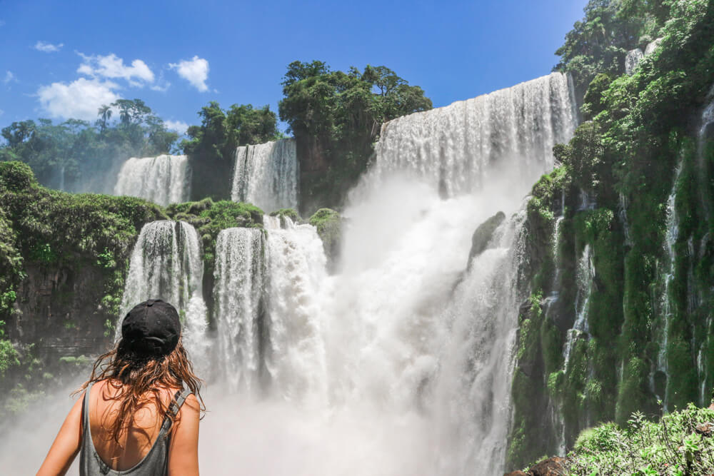 Me at Iguazu falls, my experience of travelling with Endometriosis